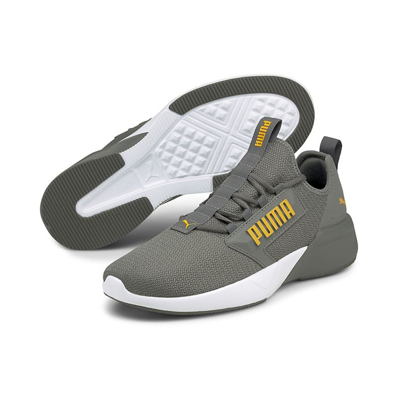 grey and yellow Puma men's laced runners with a zoned rubber outsole from O'Neills