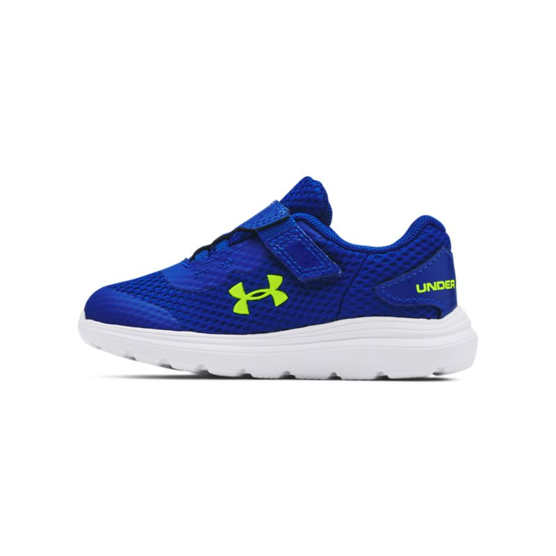 royal, yellow and white Under Armour kids' runners, lightweight and comfortable with an adjustable hook & loop strap from O'Neills